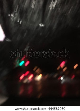 Blurred Defocused Light of Heavy traffic on a wet rain city road at night - stock photo