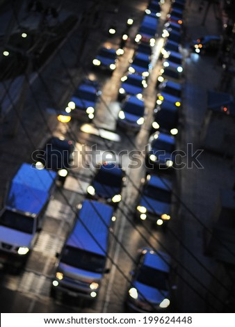 Blurred Defocused Lights of Heavy Traffic on a Congested Road at Night - Commuting at Rush Hour Concept - stock photo