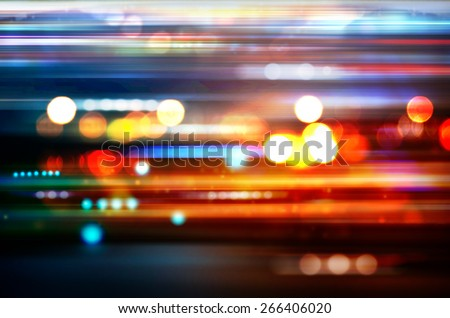 Blurred Defocused Lights of Heavy Traffic on a Wet Rainy - stock photo