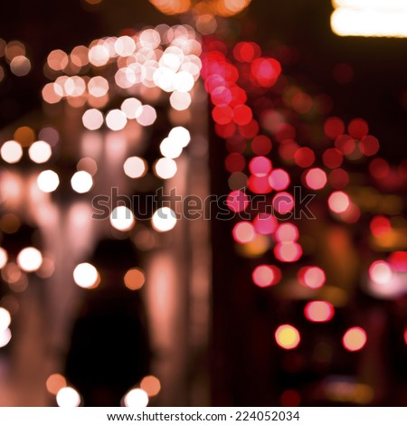 Blurred Defocused Lights of Heavy Traffic on a Wet Rainy City Road at Night - Commuting at Rush Hour Concept  - stock photo