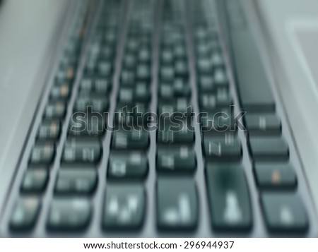 Blurred defocused motion effect on the computer keyboard