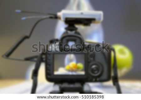 Blurred Digital single lens reflex camera on tripod shooting for stock photos