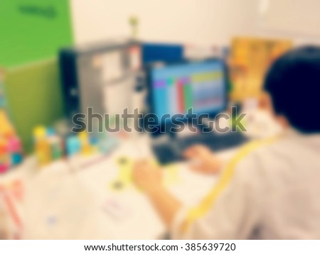 Blurred employees working office style vintage tone. - stock photo