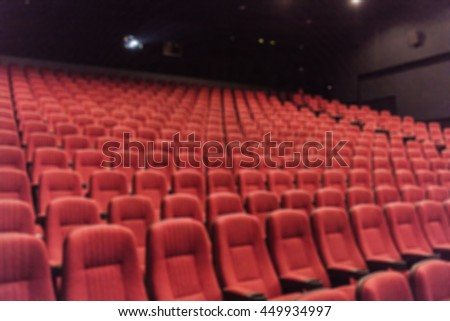 Blurred empty red cinema seats background.