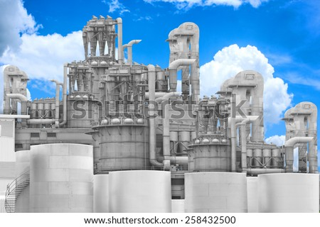 blurred engineer maintaining record at petrochemical Industrial plant with blue sky - stock photo