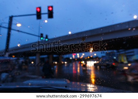 Blurred evening traffic on the city road.The bokeh from traffic light and car light .  - stock photo