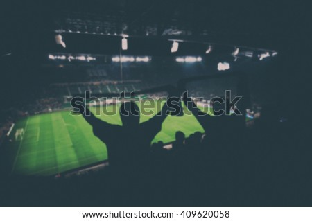 blurred fans on football stadium, vintage effect - stock photo