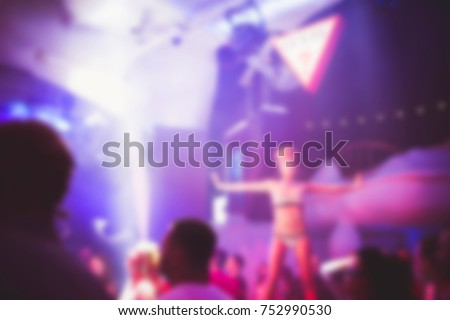 Blurred for background. Night club dj party people enjoy of music dancing sound with colorful light with Smoke Machine and lights show. Hands up in earth.