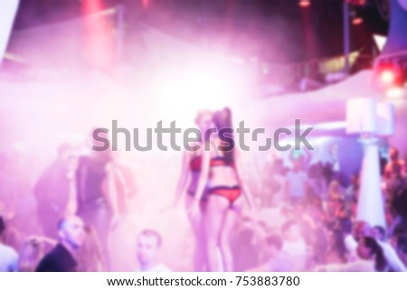 Blurred for background. Night club dj party people enjoy of music dancing sound with colorful light with Smoke Machine and lights show.
