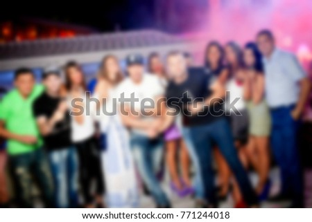 Blurred for background. night club party. People during concert in night club party. Blurred Crowd People. Abstract blurry festival event with beautiful lights decoration inside night club background