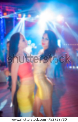Blurred for background. night club party. People smiling and posing on cam during concert in night club party. Man and woman have fun at club. Boy and girl at night club party