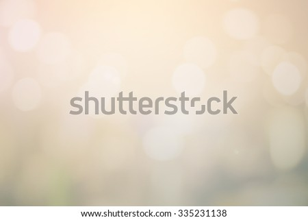 blurred golden bronze backgrounds:blur of celebration wallpaper concept:soft focus concept:blur of bokeh metal circle light christmas festival backdrop concept.golden hours conceptual. - stock photo