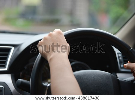 blurred hand driving on the street