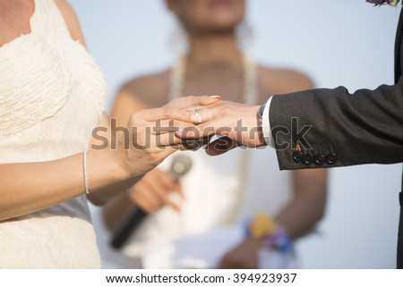 Blurred Hand of the groom and the bride with wedding rings