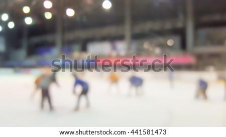 blurred ice hockey in indoor stadium