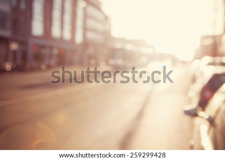Blurred image a street.