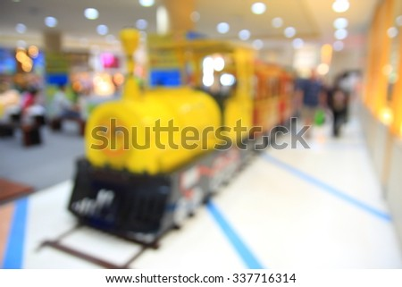 blurred image Children's playground at public park - stock photo
