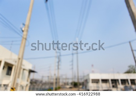 Blurred image. High voltage electric power substation - stock photo