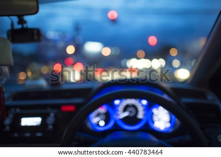 Blurred image  inside a car with bokeh of traffic light and another car with soft flare