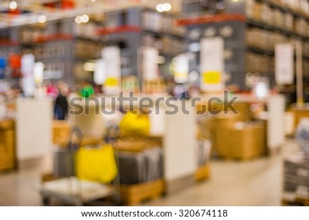 Blurred image inside a warehouse with multi-layer shelves. - stock photo