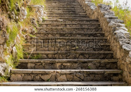 Blurred image of a stone staircase - stock photo