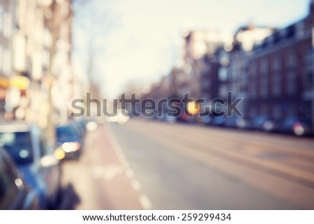 Blurred image of a street.  - stock photo