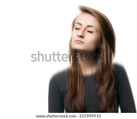 Blurred image of a young woman with closed eyes. Isolated on white with copy-space. Intentional motion blur.