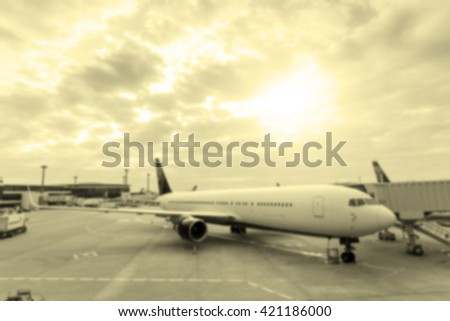 Blurred image of an airplane with retro color effected
