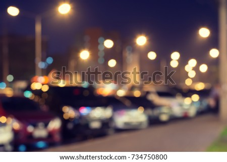Blurred image of cars at roadside parking lots and footpath at night with bokeh lighting background & Blurred Image Cars Roadside Parking Lots Stock Photo (Download Now ...