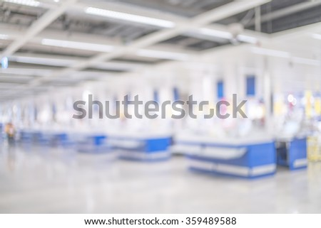 Blurred image of Cashier counter in supermarket store for background uses.