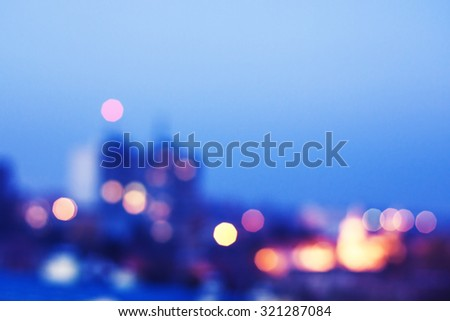 Blurred image of city at night - stock photo