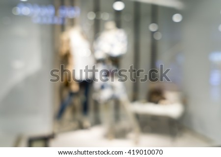 Blurred image of clothes shop for background uses. - stock photo