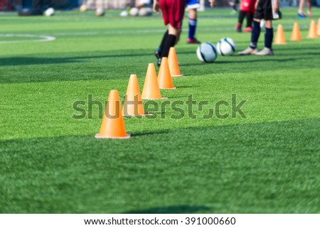 blurred image of Coach is coaching Children Training In Soccer Team - stock photo