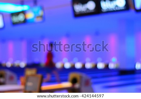 Blurred image of colorful bowling arena with circle light or bokeh. Concept for blur background, competition, hobby, team, defocus