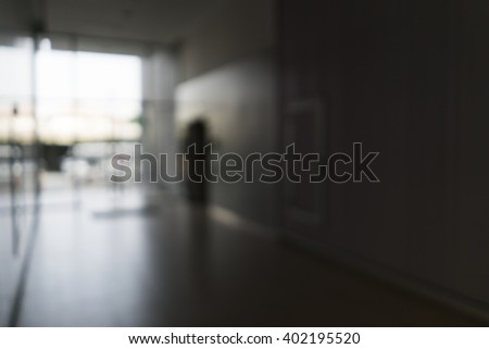 Blurred image of entrance door of modern building for background use - stock photo