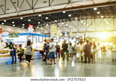Blurred image of event with people for background - stock photo