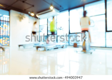 Blurred image of fitness activity with bokeh for background usage, People on treadmill