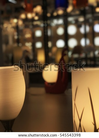 Blurred image of lamp shop.