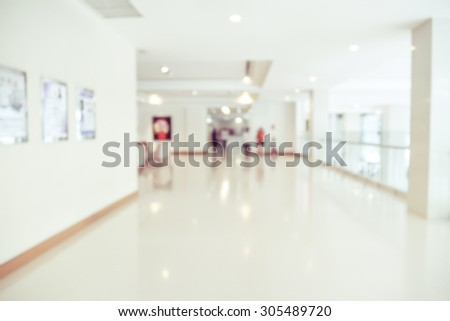 blurred image of modern hospital - corridor hallway - stock photo