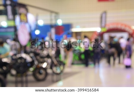 blurred image of motor show,show room,motor expo for background