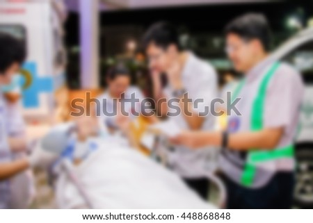 Blurred image of moving patient to emergency room at hospital - stock photo