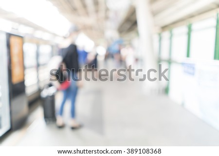 Blurred image of people at train station for background use