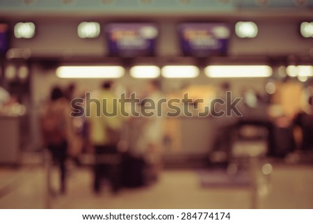 Blurred image of people in queuing at airport checking in counter, toned photo, vintage filter - stock photo