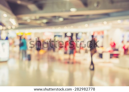 Blurred image of people in shopping mall with bokeh, vintage color - stock photo