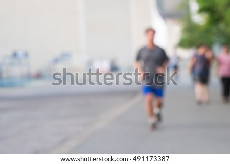 Blurred image of people jogging at the park