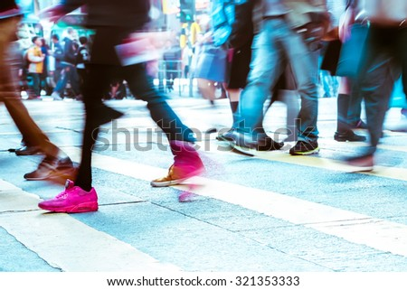 Blurred image of people moving in crowded city street. Art toning abstract urban background. Hong Kong