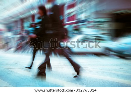 Blurred image of people moving in crowded night city street. Art toning abstract urban background. Hong Kong - stock photo