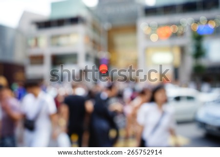Blurred image of people moving in crowded night city street with shopping malls. Malaysia. Blur effect and soft focus - stock photo