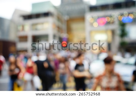Blurred image of people moving in crowded night city street with sopping malls. Malaysia. Blur effect and soft focus - stock photo