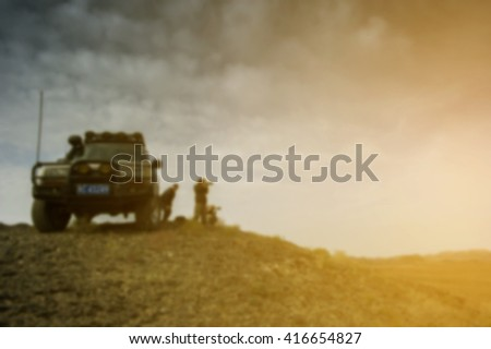 blurred image of photographer pose for photo with advanture car near sunset of mongolia desert and cross process soft flare filter